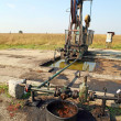 Oil wells with polluted ground — Stock Photo