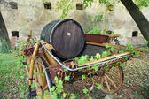 Old wooden barrel on the carriage — Stock Photo
