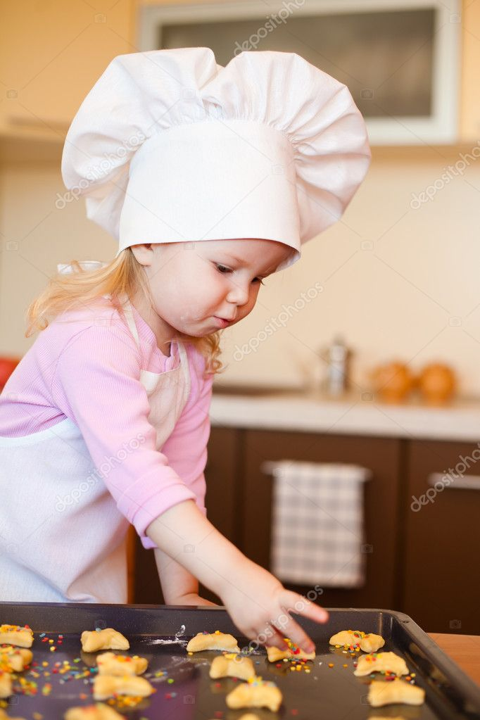 Little girl preparing cookies on kitchen  Stock Photo #5307342