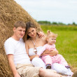 Royalty-Free Stock Photo: Happy family in haystack or hayrick