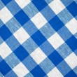 Blue horizontal checked fabric tablecloth — Stock Photo