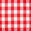 Stock Photo: Red checked fabric tablecloth