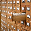 Old wooden card catalogue with one opened drawer — Stock Photo #5312787