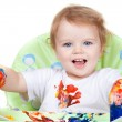 Baby child creates art picture with paints as artist (#4 from se - Stock Photo