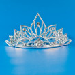 Tiara or diadem with reflection on blue background — Stock Photo #5313051