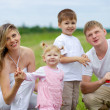 Happy family fly a kite together in summer field — Stock Photo