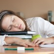 Schoolgirl is sleeping with her books at lesson — Stock Photo