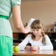 Teacher rebukes schoolgirl about mobile phone usage during lesso — Stock Photo