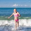 Stock Photo: Close-up girl running from sewave