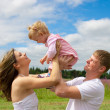 Happy family in field  or meadow — Stock Photo
