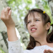 Cute brunette girl standing outdoor holds found larva — Stock Photo