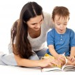 Royalty-Free Stock Photo: Mother and son reading book together isolated on white