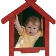 Baby-girl inside of toy house — Stock Photo #5313748