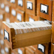 Old wooden card catalogue with one opened drawer — Stock Photo
