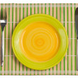 Bamboo placemat with plate fork and knife isolated on white - Foto de Stock  