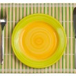 Bamboo placemat with plate fork and knife isolated on white - Foto Stock