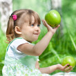 Royalty-Free Stock Photo: Little girl portrait with 2 green apples in her hands outdoor
