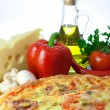 Homemade pizza and ingredients — Stock Photo