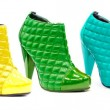 Stock Photo: Variety of all rainbow colors in patent leather shoes or boots a