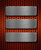 Three metal plates over red grid background — Stock Photo