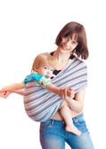 Young women and 2 years son with sling - tutorial how to put on — Stock Photo