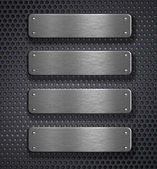 Four metal plates over grid background — Zdjęcie stockowe