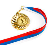 Golden medal on white — Stock Photo