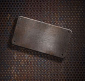 Grunge rusty metal plate over grid background — Stock Photo