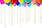 Colorful balloons filled with helium and with golden streamers isolated on — Stock Photo
