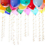 Colourful balloons filled with helium and with golden streamers — Stock Photo