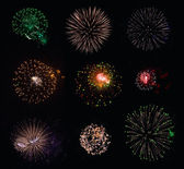 9 isolated fireworks explosions on black background — Stock Photo