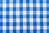 Blue checked fabric tablecloth — Stock Photo
