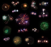 Big collection of 18 real fireworks isolated on black background — Stock Photo