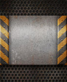 Grunge metal plate with black and yellow stripes — Stock Photo