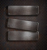 Three grunge rusty metal plates over grid background — Stock Photo