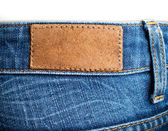 Blank leather label back view of weared jeans — Stock Photo