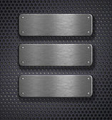 Three metal plates over grid background — Stock Photo