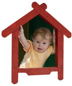 Baby-girl inside of toy house — Stock Photo