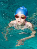 Swimmer girl finishing — Stock Photo
