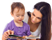 Mother and son reading book together isolated on white — Стоковое фото