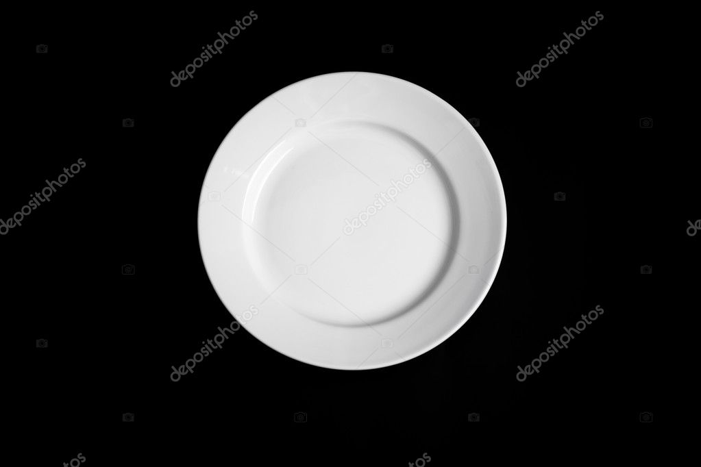 White round plate isolated on black background — Stock Photo #5312302