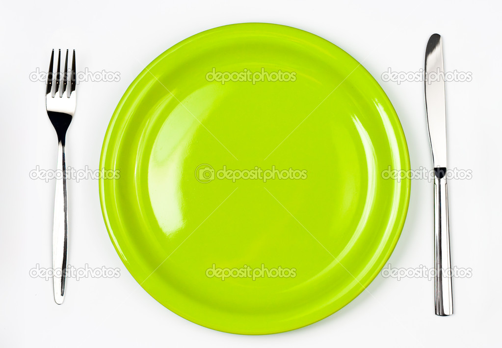Knife, green plate and fork — Stock Photo #5312307