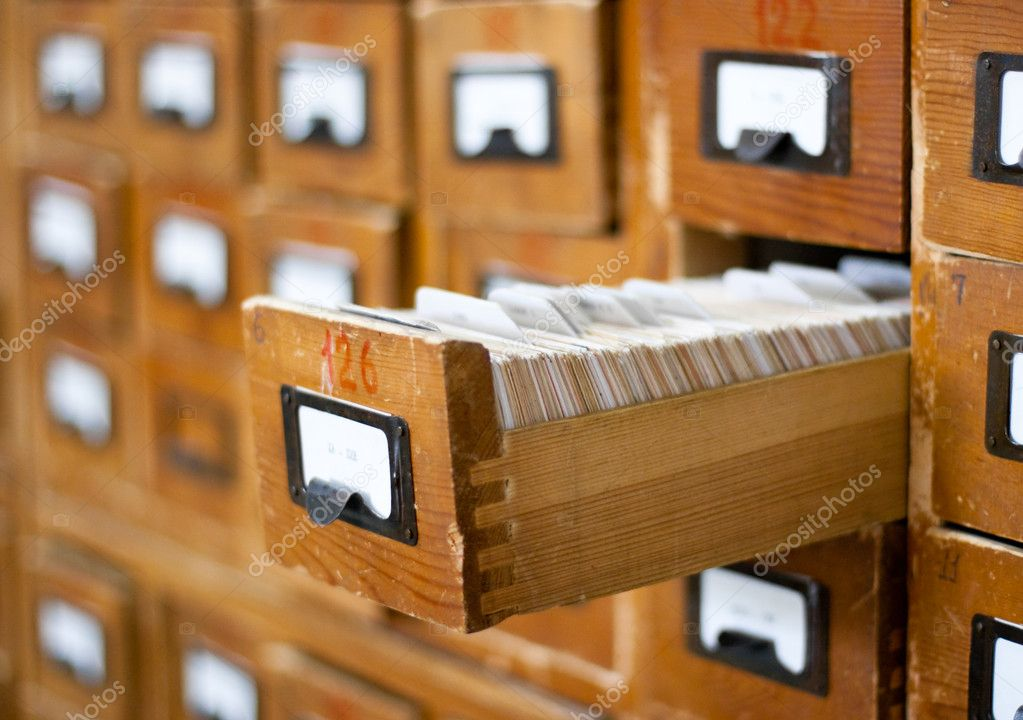 Old wooden card catalogue with one opened drawer — Stock Photo #5313121