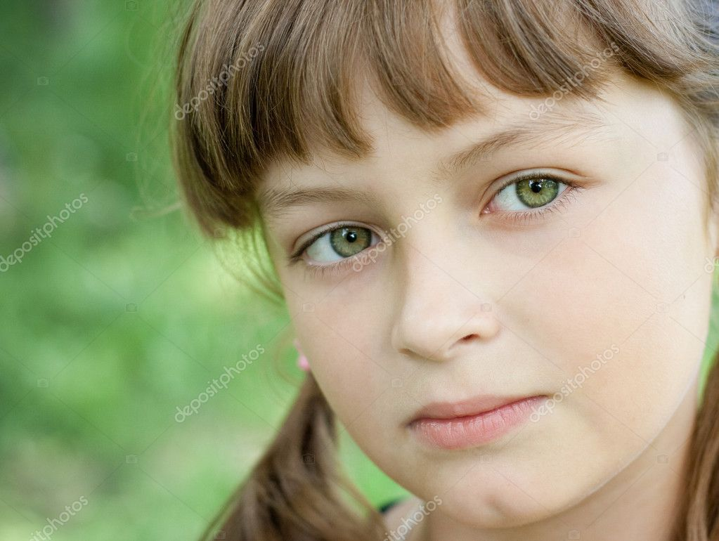 Little Girl with Green Eyes and Blonde Hair