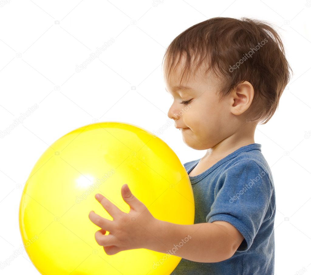 Cute toddler boy is playing with yellow balloon — Stock Photo #5314327