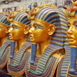 A number of statues of pharaohs in the gift shop - Stock Photo