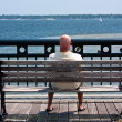 Man Watching Sailboats - Stock Photo