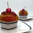 Cupcake with a cherry on top — Stock Photo