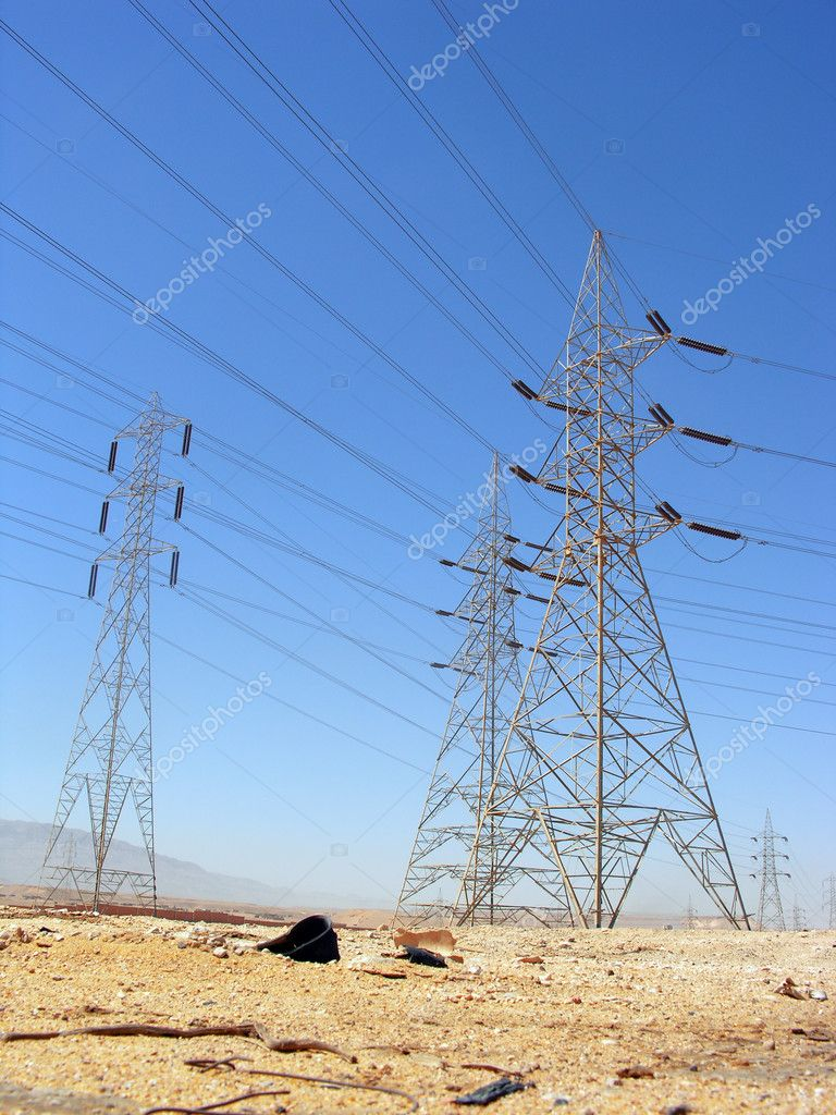 Telephone line and electricity towers in the desert — Stock Photo #4664689
