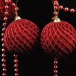 Red christmas balls over black — Stock Photo #3999603